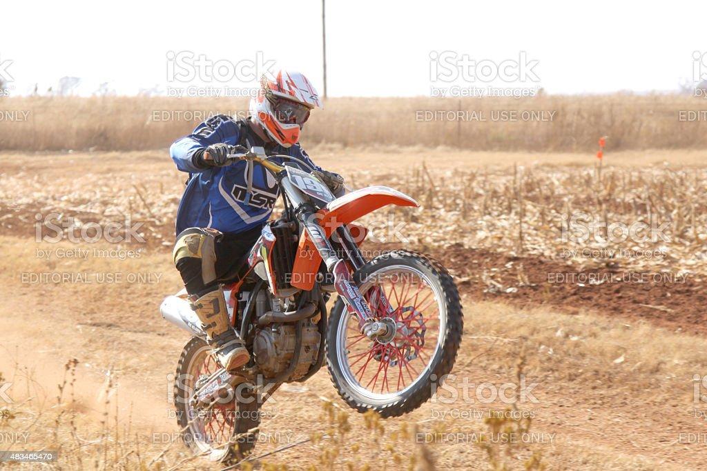 Motorbike wheelie on back wheel at rally stock photo