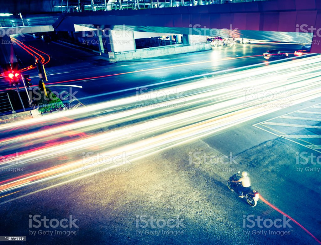 Motorbiker at an intesection in Bangkok. royalty-free stock photo