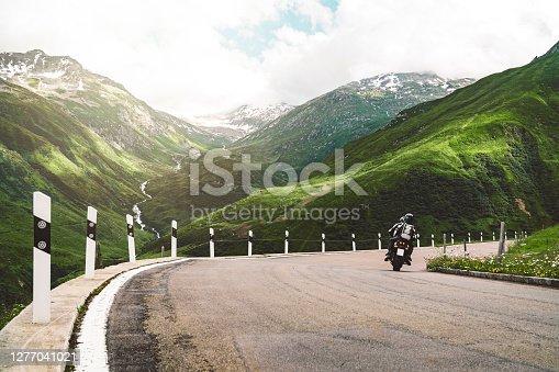 istock Motorbiker on Furka pass road 1277041021