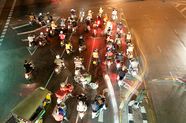 motorbikes at a busy junction - motorbike, umbrella stock pictures, royalty-free photos & images