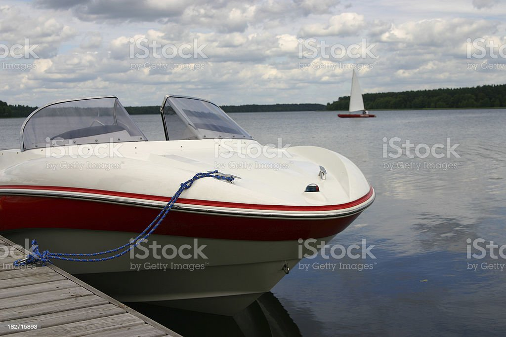 Motorboat and sailboat royalty-free stock photo