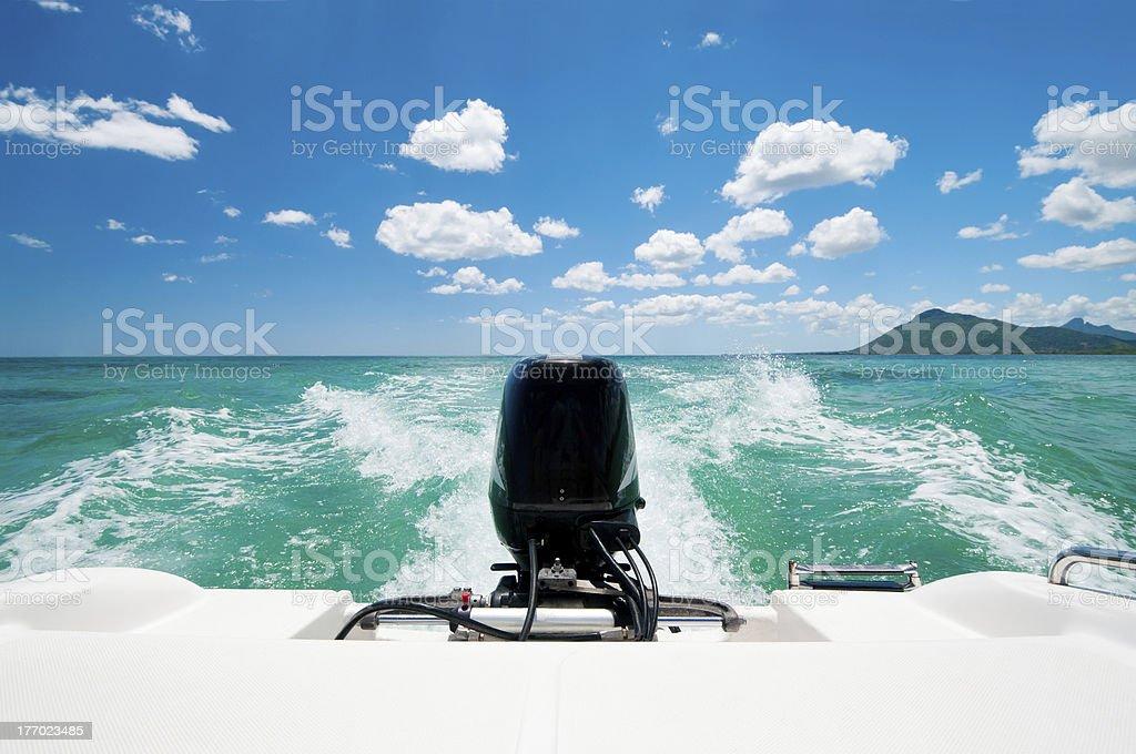 Motorboat in caribbean ocean stock photo