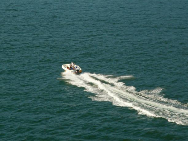 Motorboat in Pacific Ocean stock photo