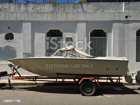 Buenos Aires, Argentina - December 15, 2018: Speedboat being kept in the street as if it was another car. Some people are water sports amateurs and have boats but no place to protect them so them leave them parked outdoors