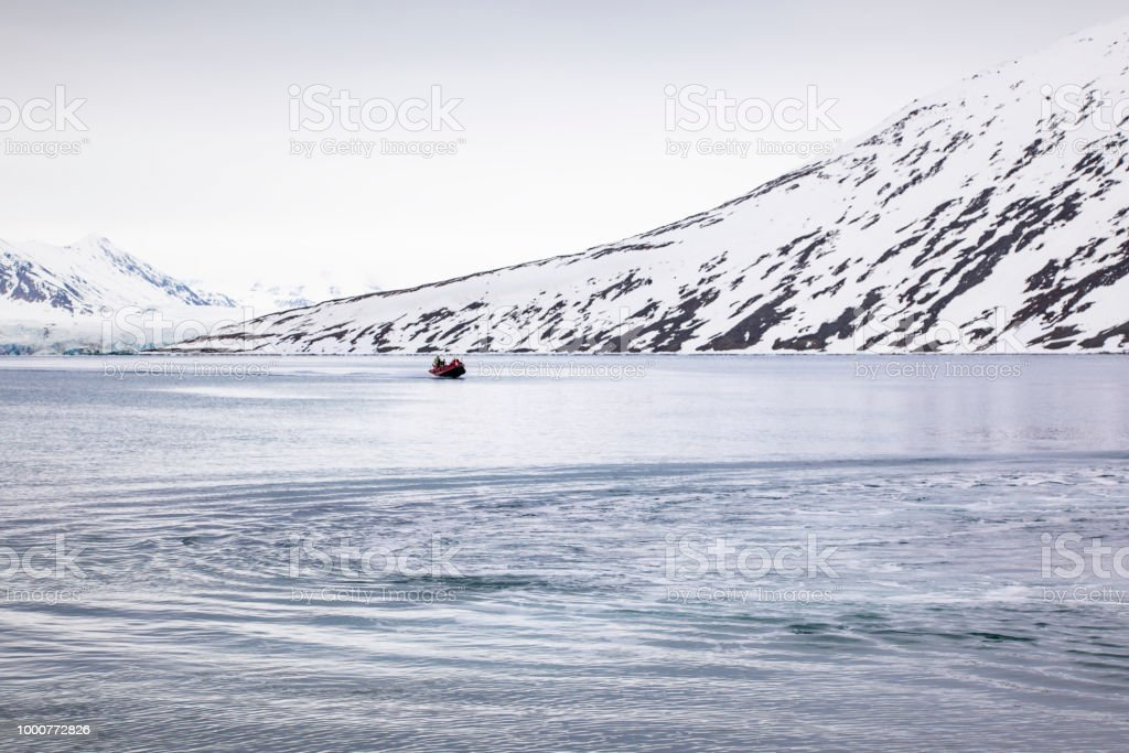 Motorboat ride through the icy waters of the Spitsbergen archipelago in Norway stock photo