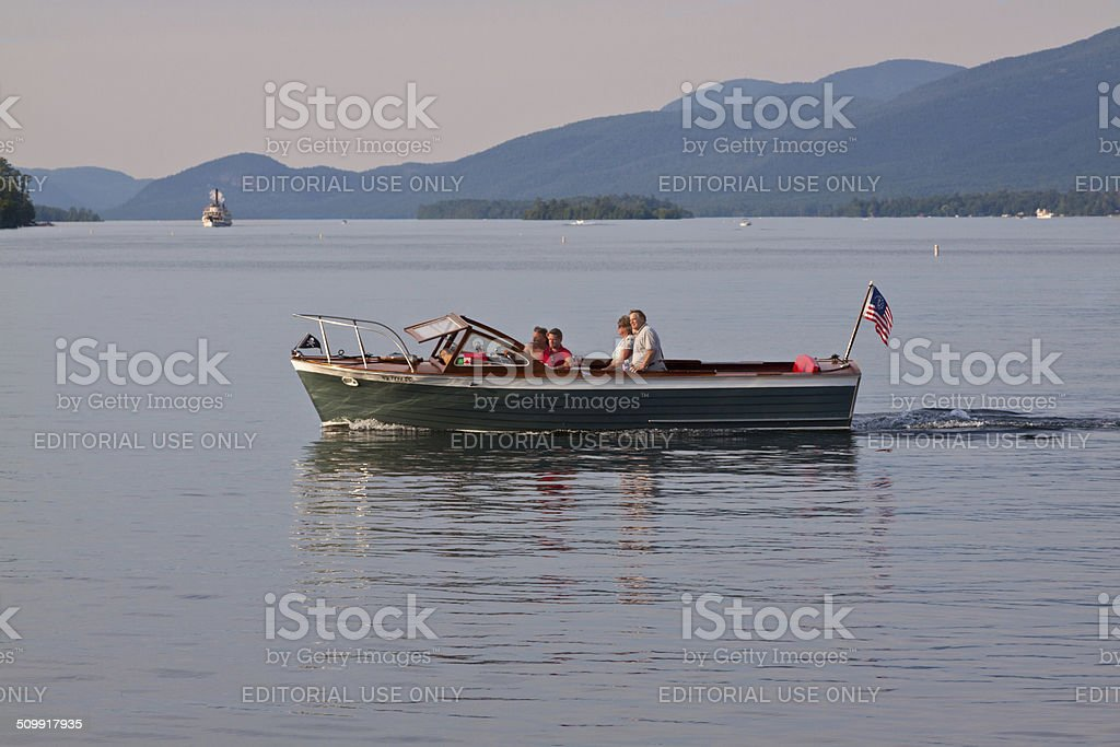 Motorboat sailing in Lake George, NY. stock photo