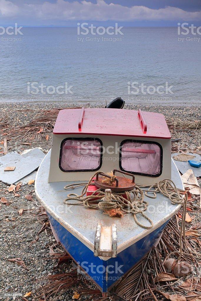 Motorboat stranded on the beach. Panngi-Pentecost island-Vanuatu. 6366 stock photo