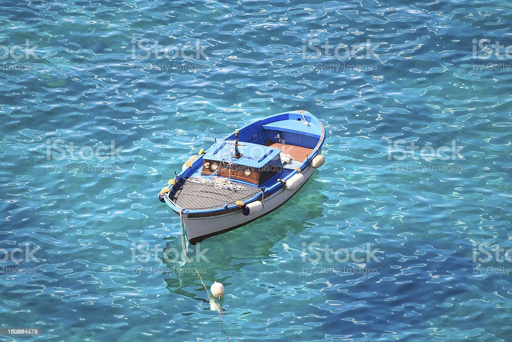 Motorboat swinging on water of Tyrrhenian sea, Ischia island (Italy) royalty-free stock photo