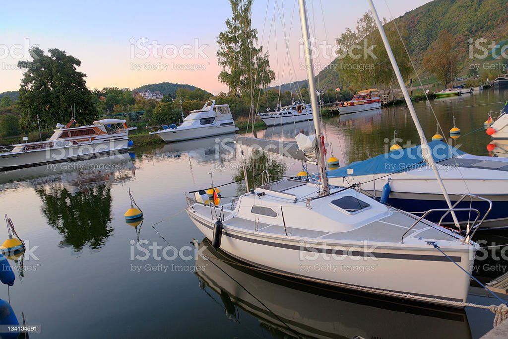 Motorboats and small yachts in a bay at dawn royalty-free stock photo