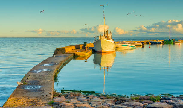 Motorboats docked at harbor in Nida village, Curonian spit, Lithuania stock photo