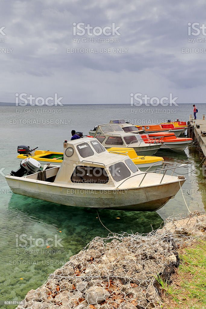 Motorboats moored to the jetty. North shore Efate island-Vanuatu. 5287 stock photo