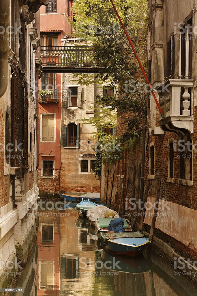 motorboats on a venetian canal royalty-free stock photo