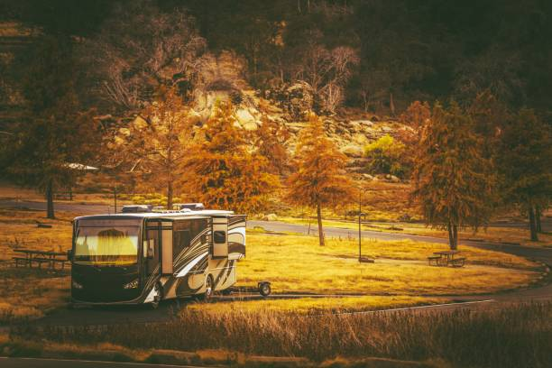 motorcoach camping time - motorhome stock photos and pictures