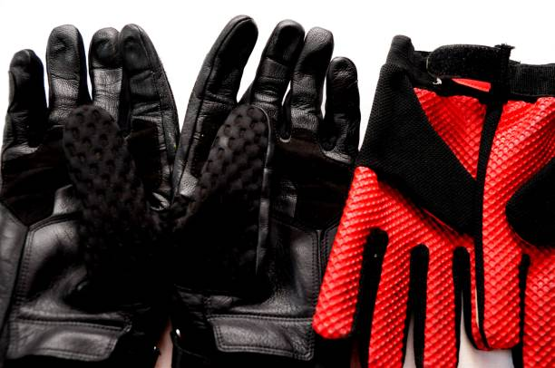 Motorcross gloves, two different pair of protection gloves stock photo