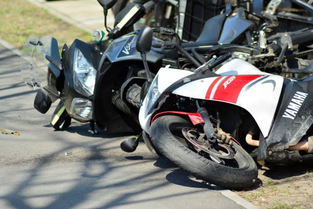 Motorcycle accident on the road. Detail of a motorcycle accident stock photo