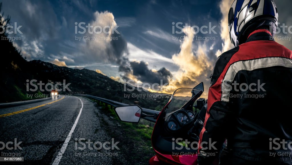 Motorcycle and Biker on Road stock photo