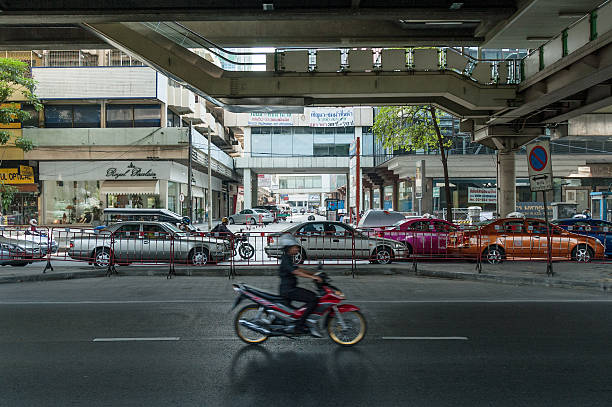 motorcycle and busy traffic in bangkok - motorbike, umbrella stock pictures, royalty-free photos & images
