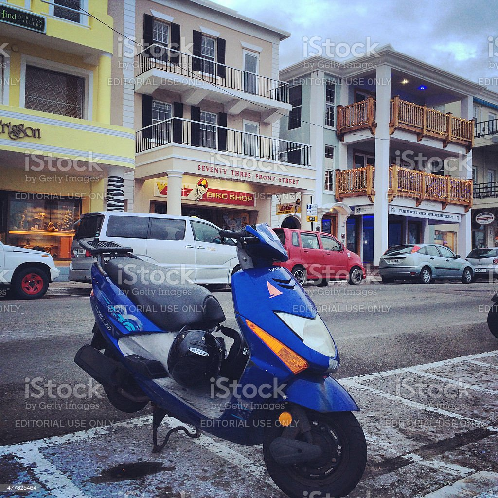 Motorcycle and cars parked on Hamilton Front Street, Bermuda stock photo