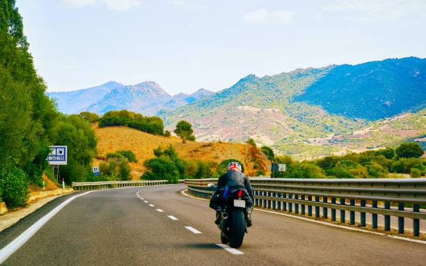 Motorcycle at road in Costa Smeralda reflex stock photo