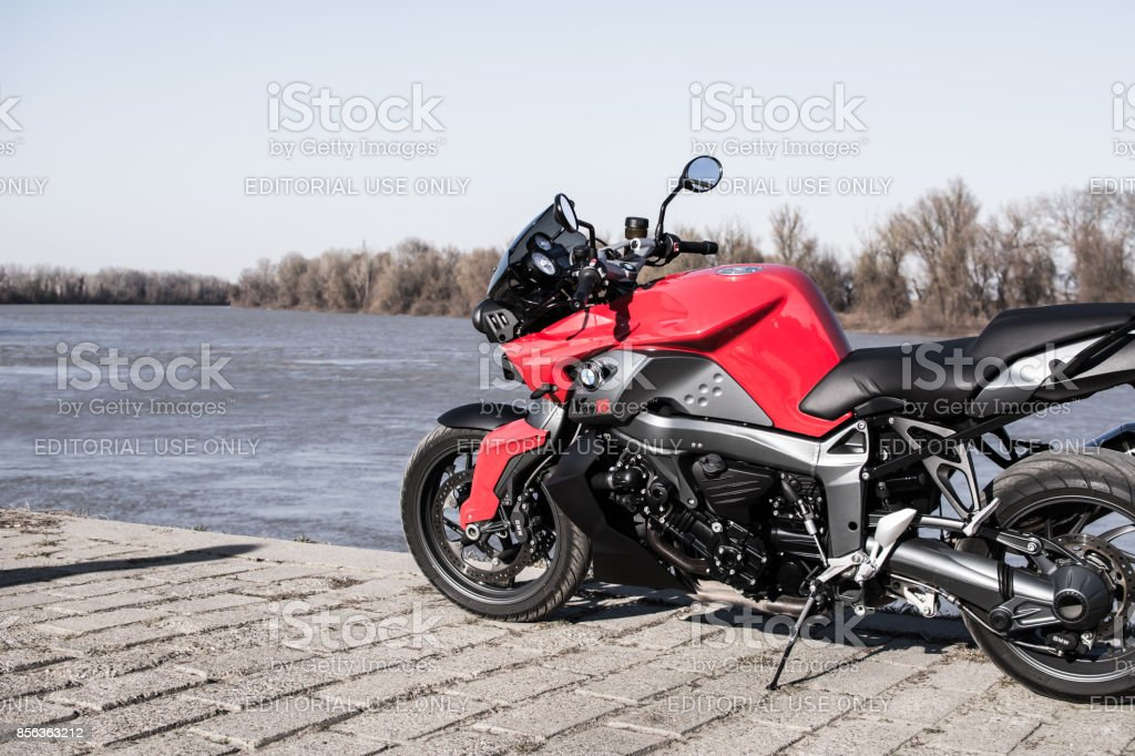 BMW K1300R motorcycle besides river stock photo