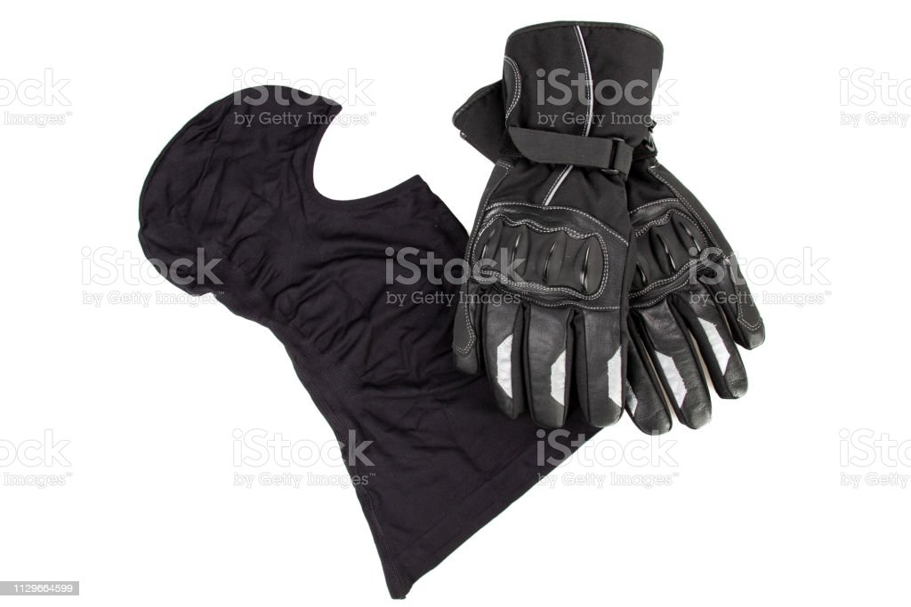 motorcycle black balaclava and gloves isolated in white background stock photo