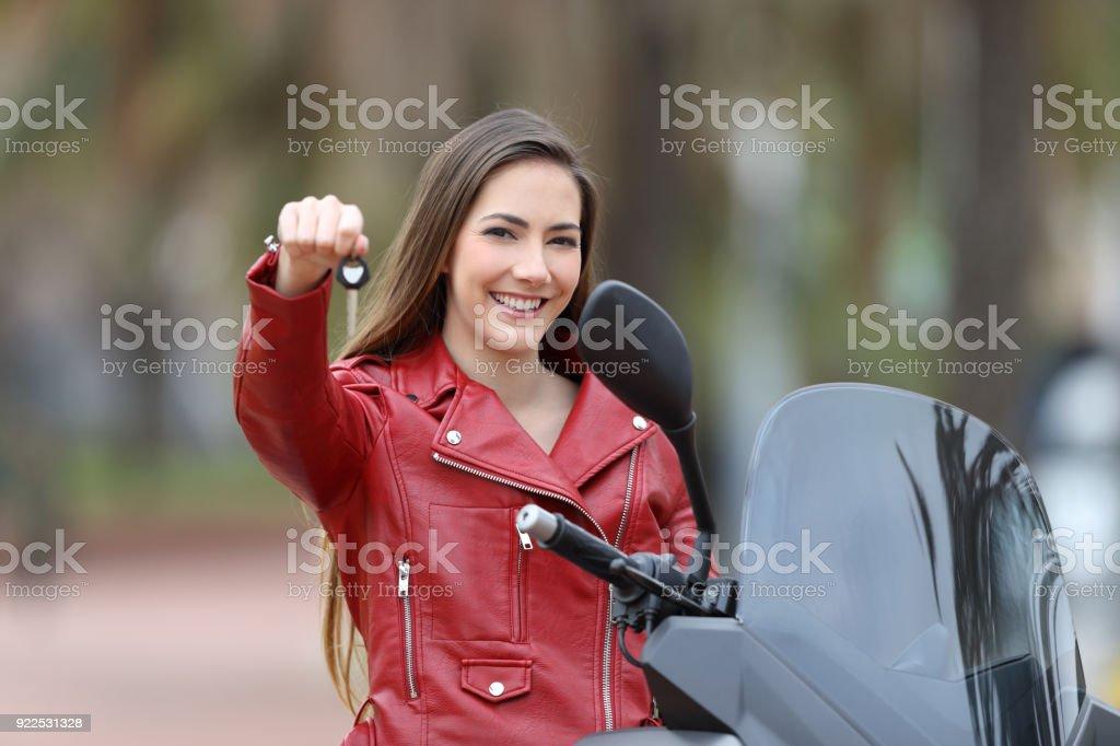 Motorcycle buyer showing keys at camera stock photo