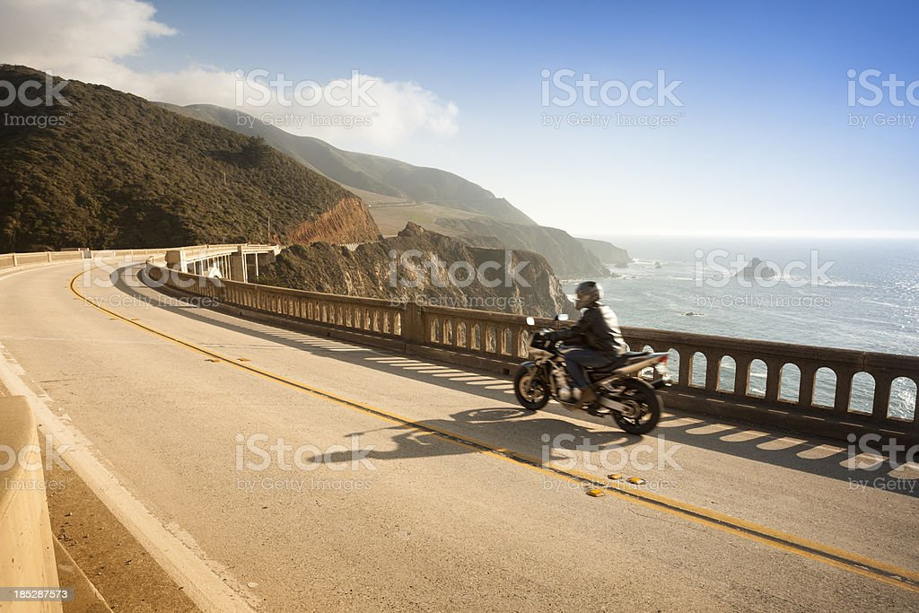 Motorcycle crossing the Bixby Bridge, Big Sur, California, USA stock photo