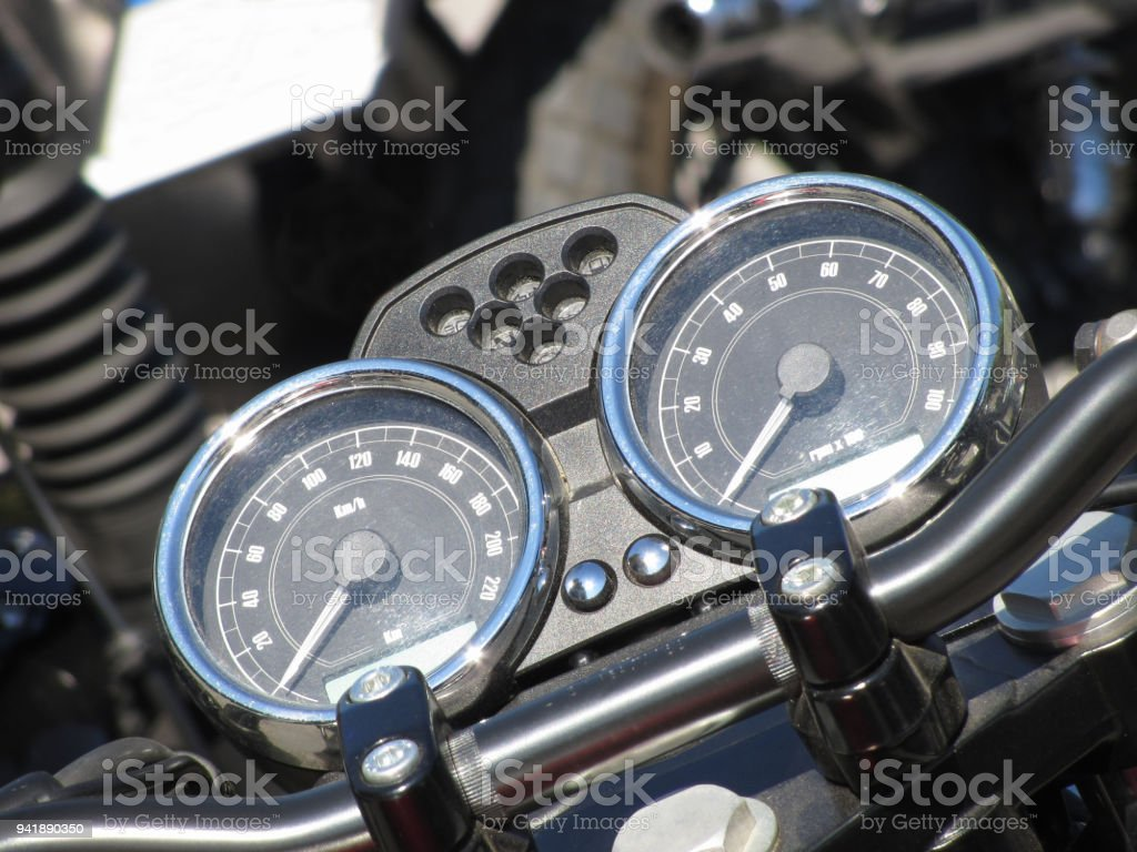 Motorcycle dash display instruments with speedometer and tachometer stock photo