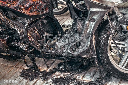 istock motorcycle destroyed in fire due to electr.. 1057473566