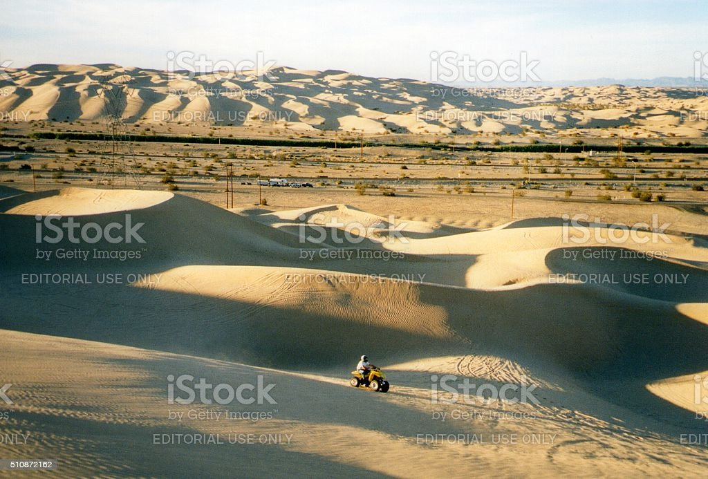 ATV motorcycle driver on Algodones dunes, Southern California stock photo
