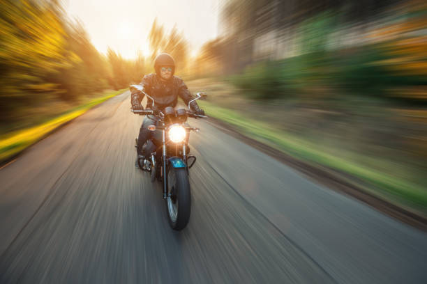 Motorcycle driver with blurred motion effect stock photo