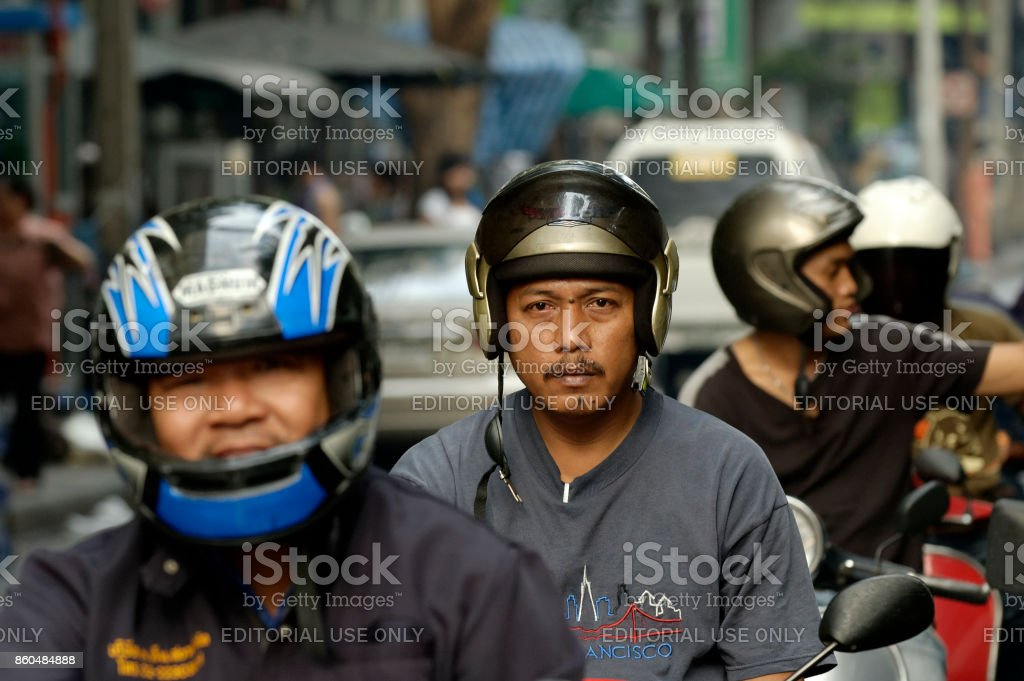 motorcycle drivers in bangkok stock photo