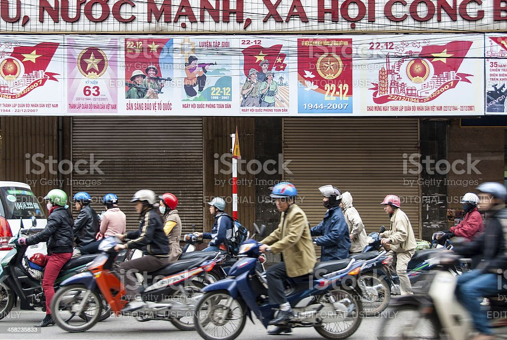 Motorcycle drivers in Hanoi, Vietnam royalty-free stock photo