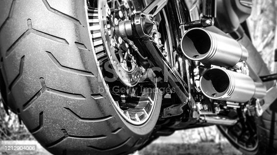 Motorcycle exhaust and rear tire profile close up
