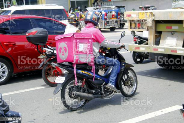 Motorcycle food delivery driver carry customer orders during the 19 picture id1225907168?b=1&k=6&m=1225907168&s=612x612&h=ivyuq8dalrikr fz7djl2izjlcajma05pf3cjxjem9o=