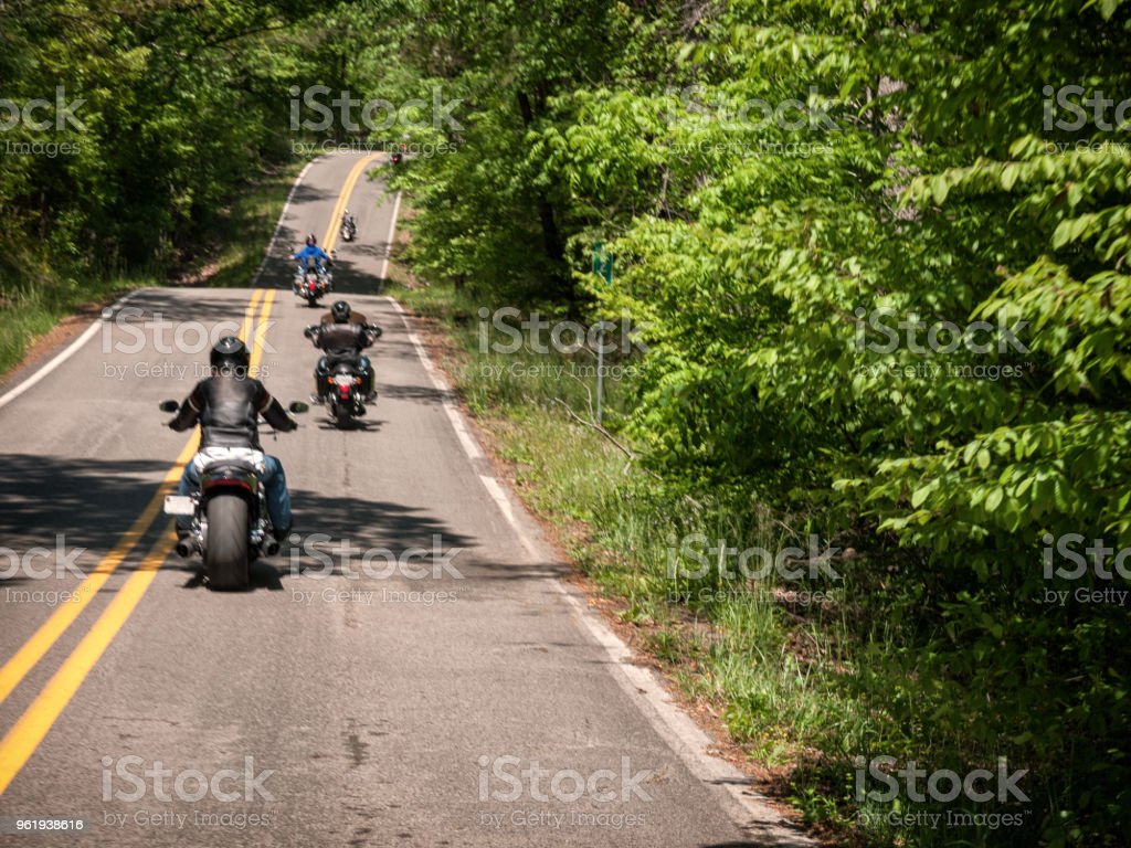 A motorcycle group ride through the countryside. stock photo