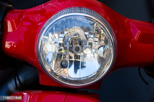 Motorcycle headlight, front view, background with copy space, full frame horizontal composition,