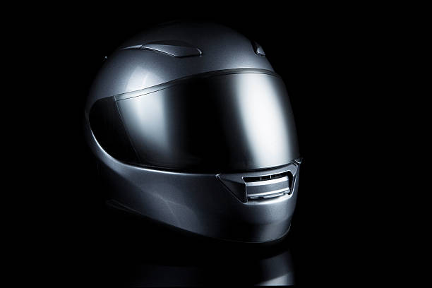 motorcycle helmet on black - helmet visor stock photos and pictures