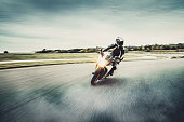 istock Motorcycle in blurred motion 1282555618