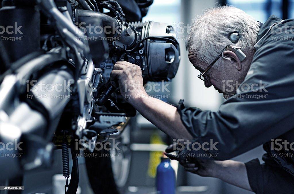 Motorcycle Mechanic at Work stock photo