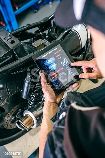 istock Motorcycle mechanic using tablet app 1019948752