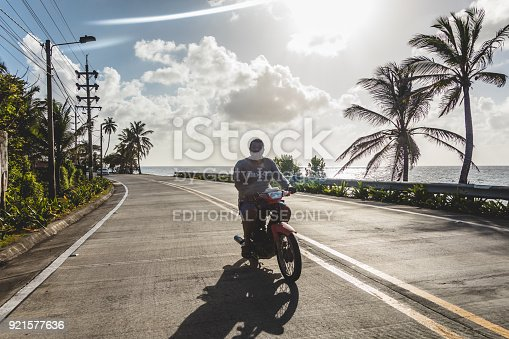 SAN ANDRES ISLAND, Colombia _ Circa March 2017. Motorcycle on the Highway. In San Andres There is a Road that do the Round Trip All Around the Island. All kind of Vehicles use this Route