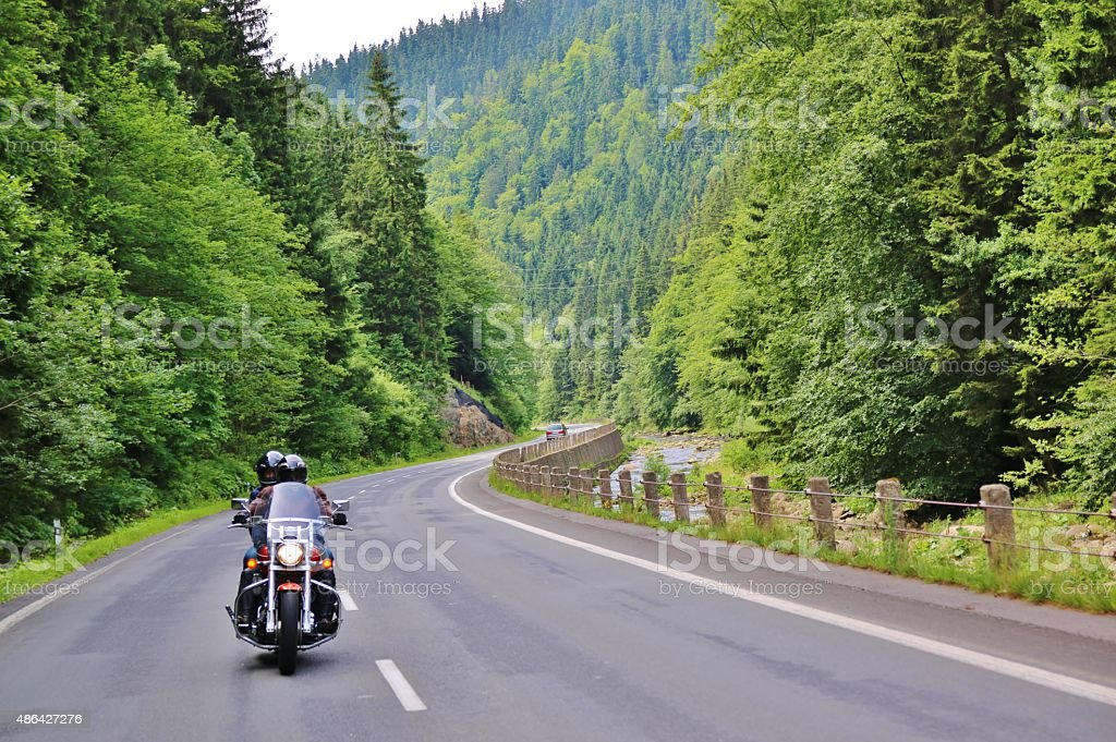 Motorcycle on the rural road stock photo