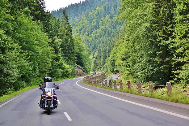 motorcycle on the rural road - biker stock photos and pictures