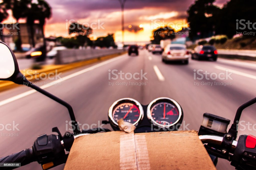 Motorcycle package delivery stock photo