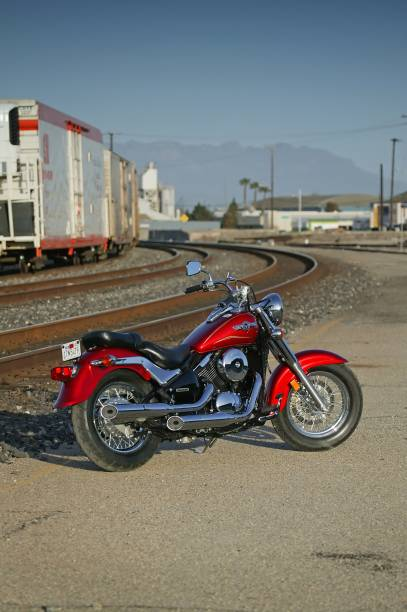 """Motorcycle parked near train tracks """"Oxnard, California USA - April 19, 2005: Kawasaki Vulcan motorcycle action shot. Kawasaki is a Japanese motorcycle manufacture of cruiser and sport bike motorcycles. The Vulcan 800 is one of their cruiser models."""" kawasaki heavy industries stock pictures, royalty-free photos & images"""