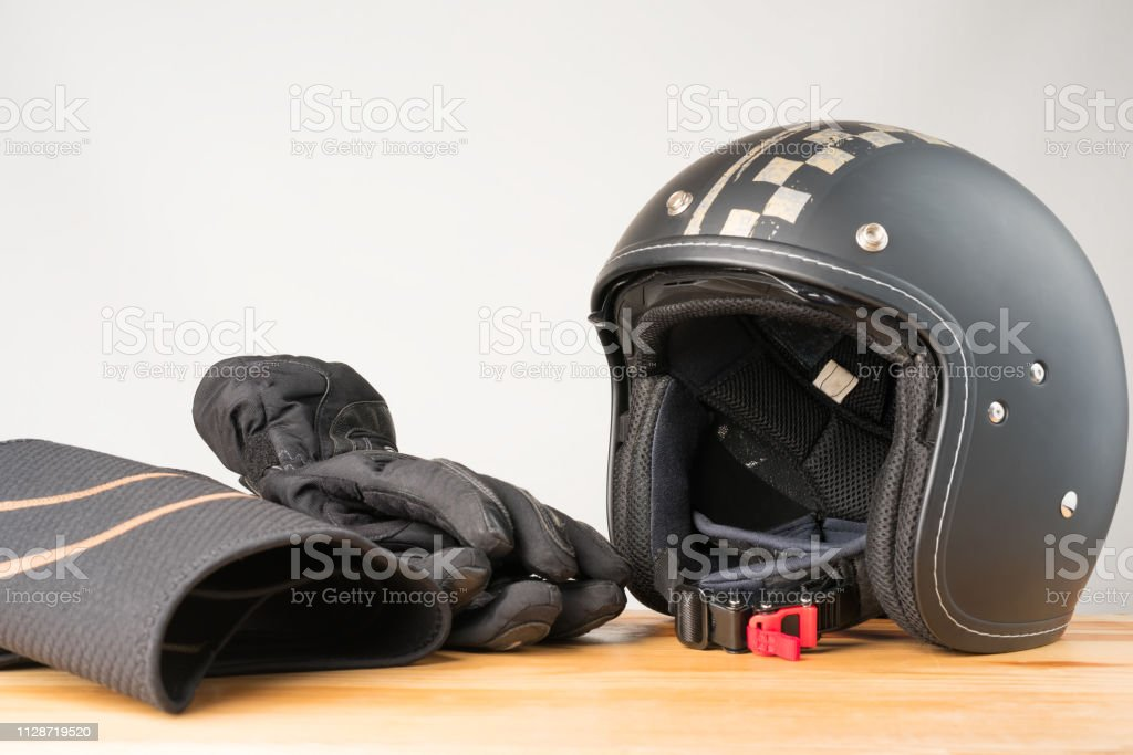 Motorcycle protective gear - helmet, gloves and kidney belt. stock photo