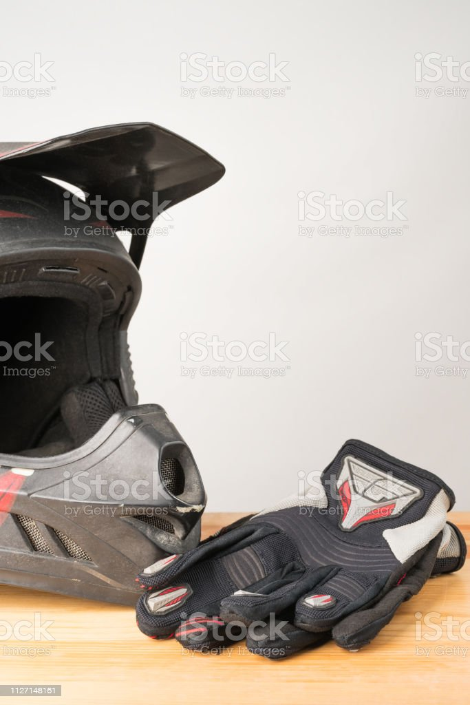 Motorcycle protective gear - motocross helmet and gloves. stock photo