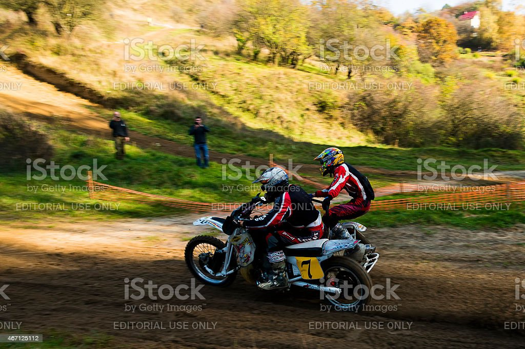 Motorcycle racer local commands during training run overcome route...