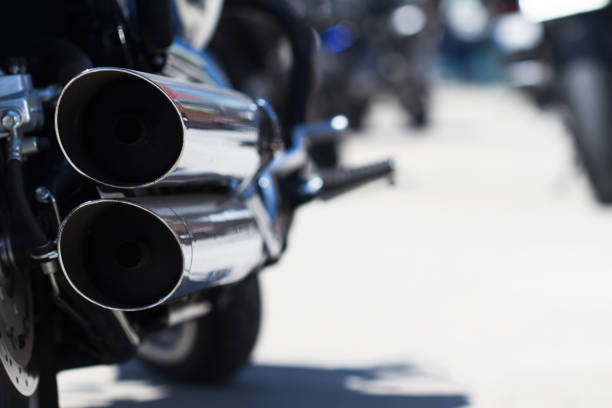 motorcycle rear exhaust pipes detail stock photo
